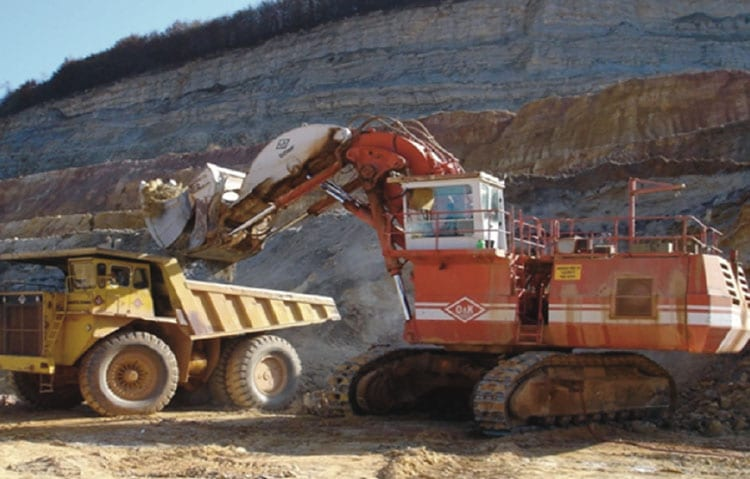 Excavator in operation loading a haul truck