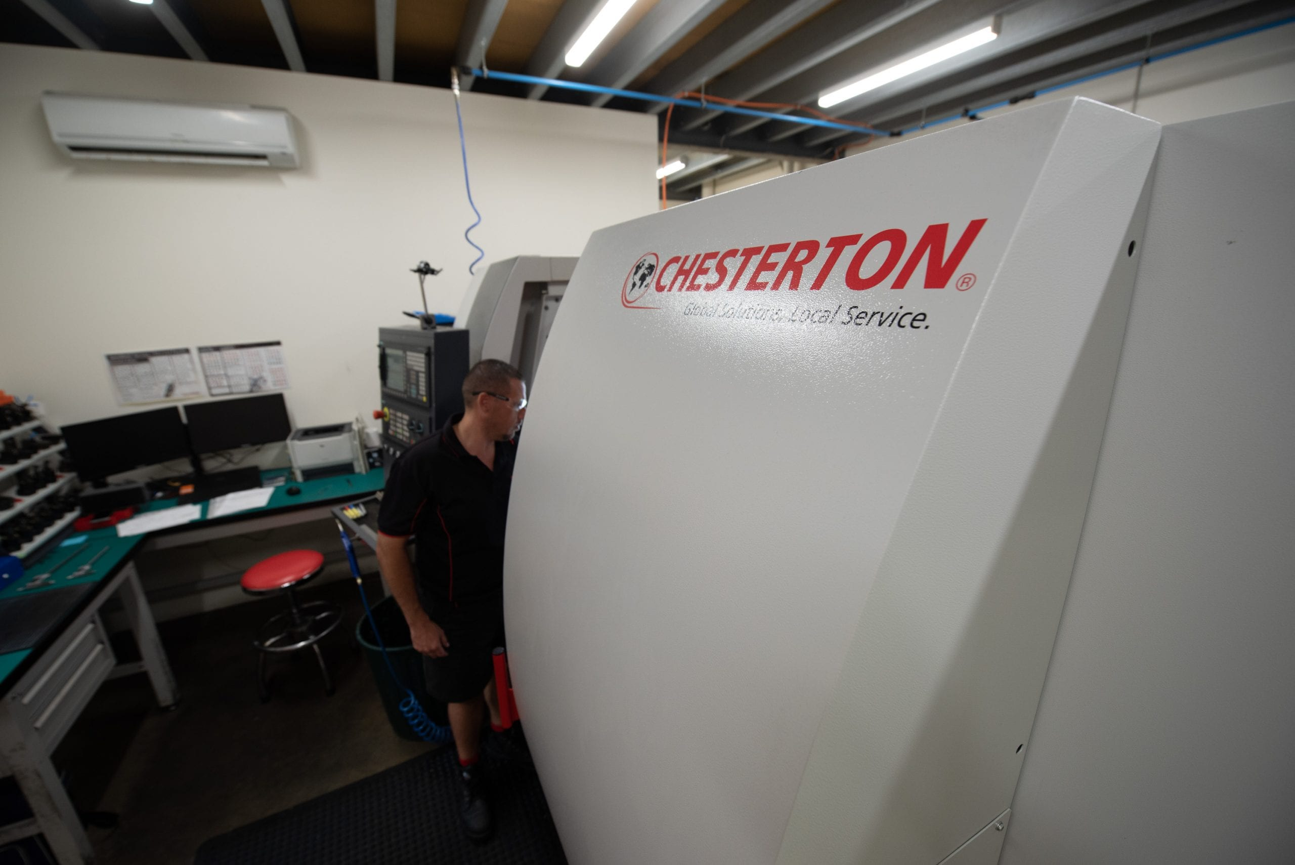 Male staff with machinery with Chesterton logo